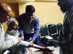 Community volunteers train Desi Senior Center members to monitor their Blood Pressure