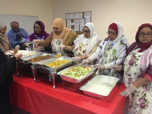 Members volunteer to serve meals